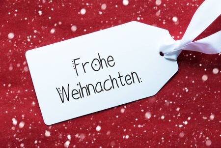 Label With German Calligraphy Frohe Weihnachten Means Merry Christmas. Red Textured Background With Snowflakes