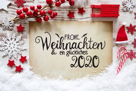 Paper With German Calligraphy Frohe Weihnachten Und Ein Glueckliches 2020 Means Merry Christmas And A Happy 2020. Bright Red Christmas Decoration Like Ball, Sled And Snowflake