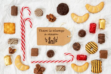 One Brown Label With English Quote There Is Always A Reason To Smile. Christmas Candy Collection With Homemade Cookies.