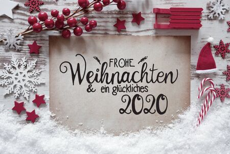 Paper With German Calligraphy Frohe Weihnachten Und Ein Glueckliches 2020 Means Merry Christmas And A Happy 2020. Red Christmas Decoration Like Ball, Sled And Snowflake 版權商用圖片