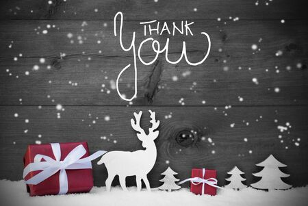 English Calligraphy Thank You. Red Christmas Decoration Like Tree, Gift, And Reindeer. Black Wooden Background With Snowfalkes