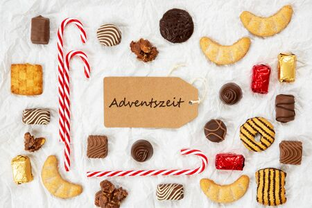 One Brown Label With German Text Adventszeit Means Advent Season. Christmas Candy Collection With Homemade Cookies.