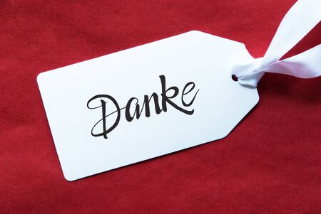 Label With German Calligraphy Danke Means Thank You. Red Textured Background 版權商用圖片