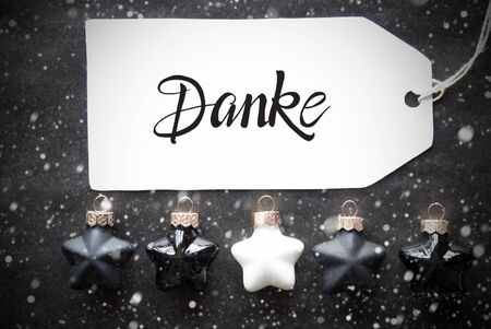 Label With German Calligraphy Danke Means Thank You. Black Christmas Ball Ornament With Snowflakes