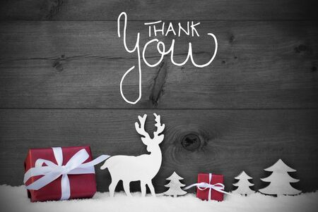 English Calligraphy Thank You. Red Christmas Decoration Like Tree, Gift, And Reindeer. Black Wooden Background With Snow Reklamní fotografie