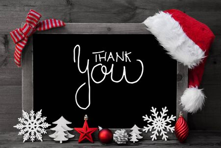 Chalkboard With English Calligraphy Thank You. Christmas Decoration Like Tree, Ball And Santa Hat. Gray Wooden Background