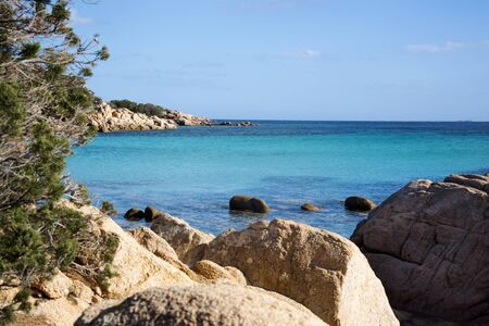 Rock Beach On The Island Of Sardinia. Beautiful Scenery And Landscape With Turquoise Ocean