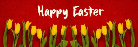 Red Wooden Background With English Text Happy Easter. Banner Of Yellow Tulip Flowers In Spring Season Imagens