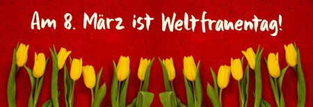 Red Wooden Background With German Text Am 8. März Ist Weltfrauentag Means International Womens Day. Banner Of Yellow Tulip Flowers In Spring Season