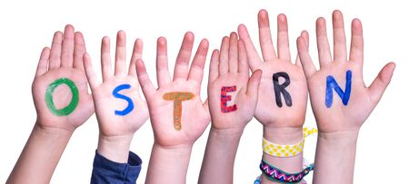 Children Hands Building Colorful German Word Ostern Means Easter. Isolated White Background