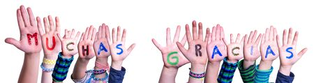 Children Hands Building Word Muchas Gracias Means Thank You, Isolated Background Stock Photo