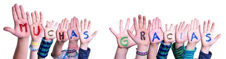 Enfants mains bâtiment mot Muchas Gracias signifie merci, fond isolé Banque d'images