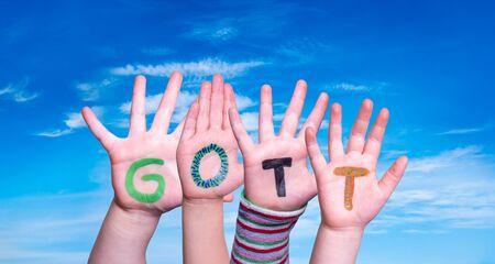 Children Hands Building Word Gott Means God, Blue Sky