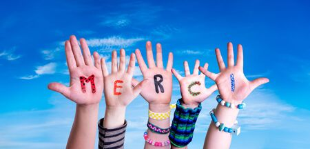 Children Hands Building Word Merci Means Thank You, Blue Sky