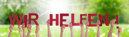 People Hands Holding Word Wir Helfen Means We Help, Grass Meadow