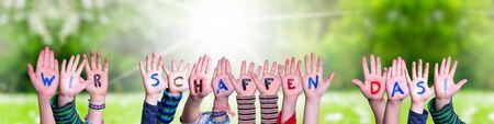 Children Hands Building Word Wir Schaffen Das Means We Can Do It, Grass Meadow