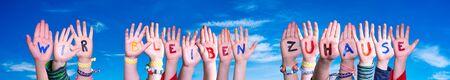Children Hands Building Word Wir Bleiben Zuhause Means We Stay Home, Blue Sky
