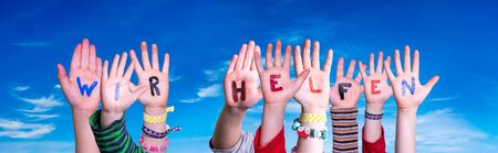 Kids Hands Holding Word Wir Helfen Means We Help, Blue Sky