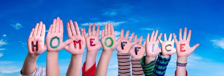 Kids Hands Holding Colorful German Word Homeoffice Means Work From Home. Blue Sky As Background