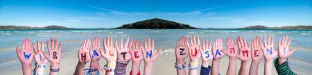Hands Building Wir Halten Zusammen Means Together We Are Stron, Ocean Background
