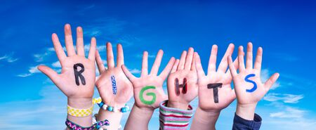 Children Hands Building Colorful English Word Rights. Blue Sky As Background