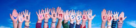 Children Hands Building Word Wir Vermissen Euch Means We Miss You, Blue Sky
