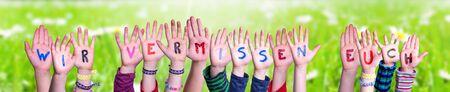 Children Hands Building Word Wir Vermissen Euch Means We Miss You, Grass Meadow Zdjęcie Seryjne