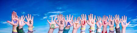Children Hands Building Colorful Word Wir Gratulieren Mean Congratulations. Blue Sky As Background