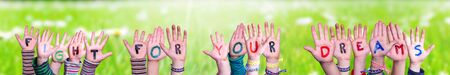 Children Hands Building Word Fight For Your Dreams, Grass Meadow