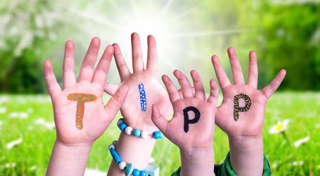 Children Hands Building Word Tipp Means Tip, Grass Meadow