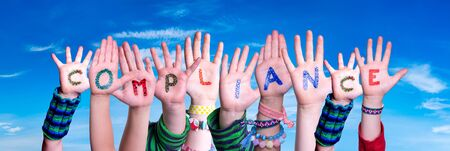 Children Hands Building Colorful Word Compliance. Blue Sky As Background