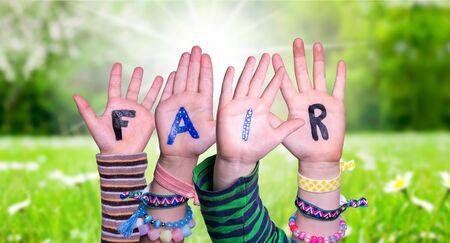 Children Hands Building Word Fair, Grass Meadow Standard-Bild