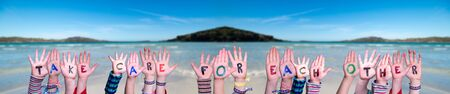 Children Hands Building Word Take Care For Each Other, Ocean Background Banque d'images