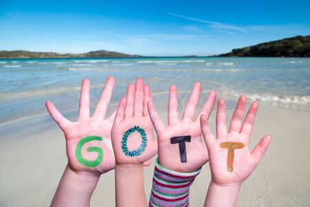Children Hands Building Colorful German Word Gott Means God. Ocean And Beach As Background