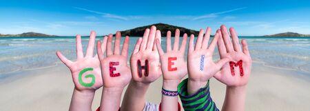 Children Hands Building Word Geheim Means Secret, Ocean Background