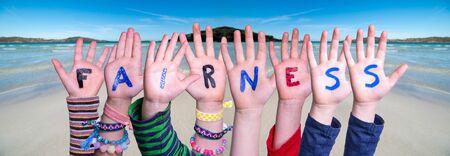 Children Hands Building Word Fairness, Ocean Background