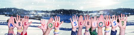 Children Hands Building Word Are You Serious, Snowy Winter Background