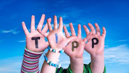 Children Hands Building Colorful German Word Tipp Means Tip. Blue Sky As Background