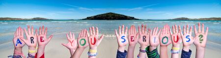 Children Hands Building Word Are You Serious, Ocean Background Banque d'images