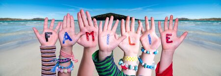 Children Hands Building Word Familie Means Family, Ocean Background 版權商用圖片