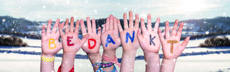 Children Hands Building Word Bedankt Means Thank You, Snowy Winter Background