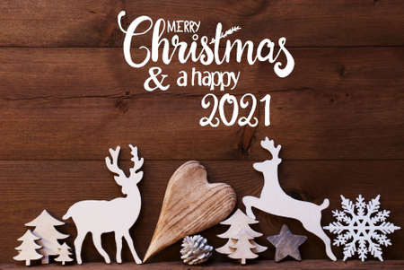 English Calligraphy Merry Christmas And Happy 2021. Christmas Ornament Like Deer, Heart, Tree And Fir Cone. Brown Wooden Background