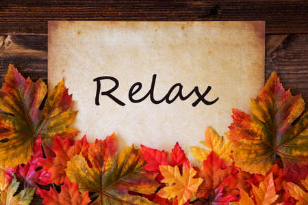 Grungy Old Paper With English Text Relax. Colorful Autum Decoration With Leaves
