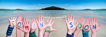Children Hands Building Word Coming Soon, Ocean Background
