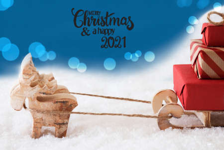 Reindeer, Sled, Snow, Blue Background, Merry Christmas And A Happy 2021