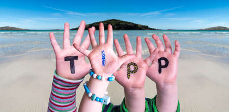 Children Hands Building Word Tipp Means Tip, Ocean Background Imagens