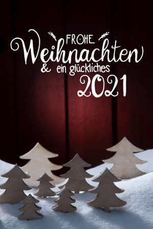 Christmas Tree, Snow, Glueckliches 2021 Means Happy 2021, Red Background Stock Photo