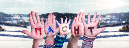Children Hands Building Word Macht Means Power, Snowy Winter Background