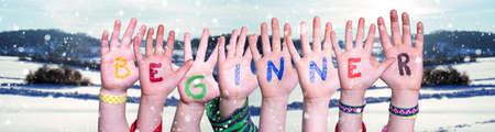 Children Hands Building Word Beginner, Snowy Winter Background