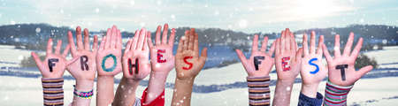 Children Hands Building Frohes Fest Means Merry Christmas, Winter Background Stock Photo